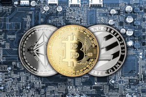 bitcoin litecoin ethereum crypto currency mining financial concept golden silver coins on hardware computer chip motherboard
